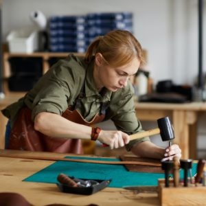 Female Craftsman Working in Shop
