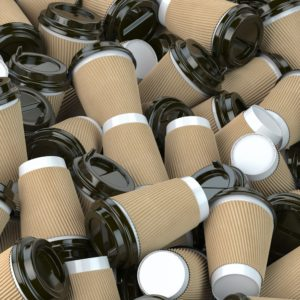 Heap of many empty paper coffee cups. Recycling of plastic waste